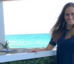 Mónica Puig llega a Puerto Rico, pero no vino sola